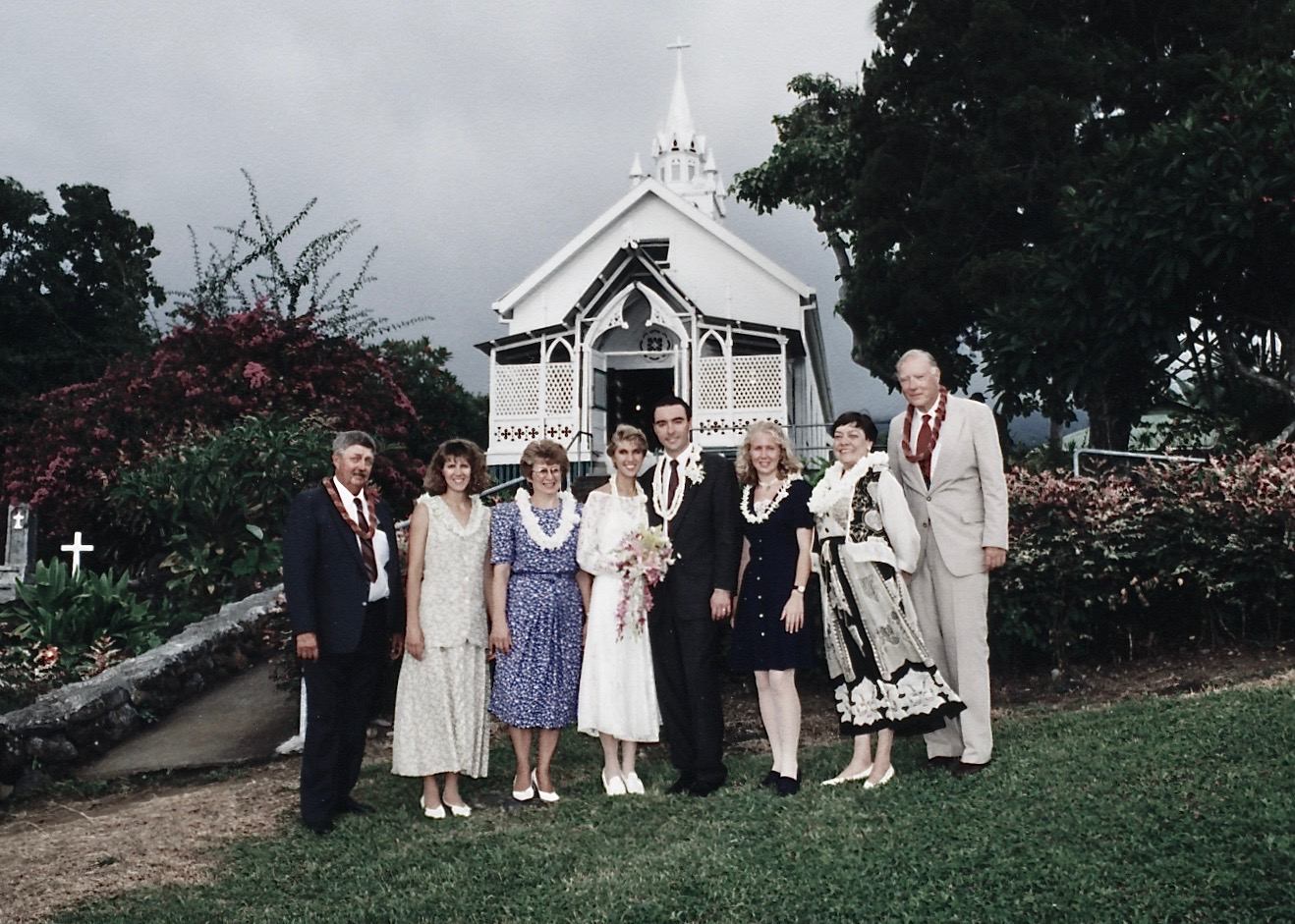 Our wedding party. with Julie's older sister (Lynda), father (Harold), mother (Judy), Julie and me, Julie's younger sister (Beth), and my folks, 1994.