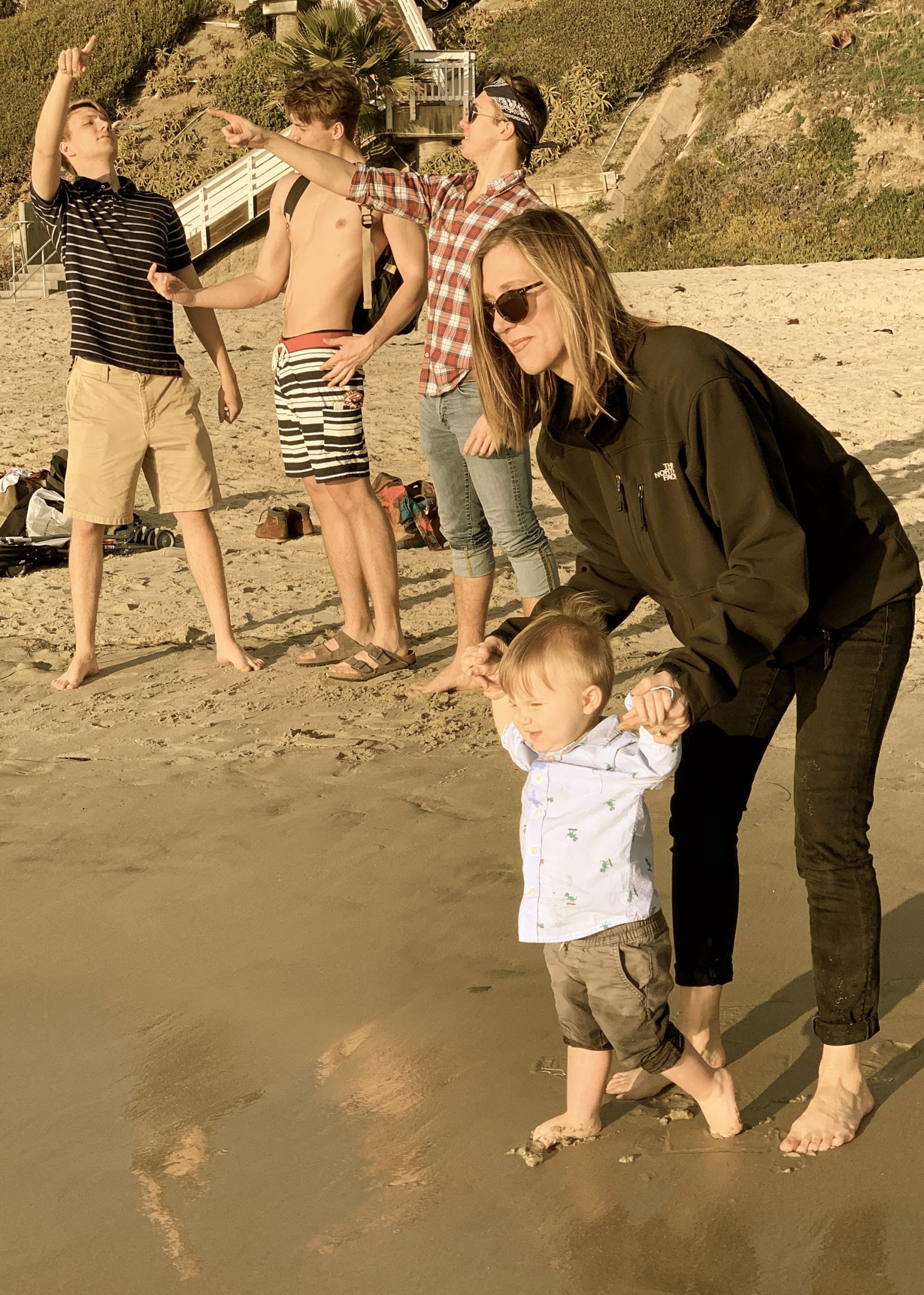Julie and Liam, with our boys photobombing in the background, in California, 2020.